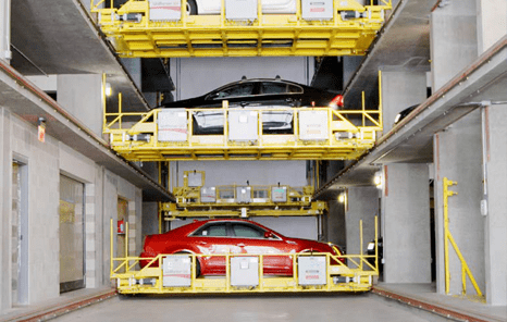 3 vehicles on lifts in U-tron's automated parking system.